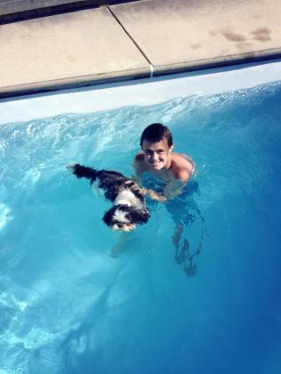 Gibby learning to swim with Will